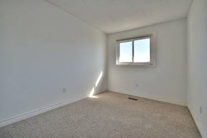 3rd Bedroom With A Mirrored Closet & Large Window.