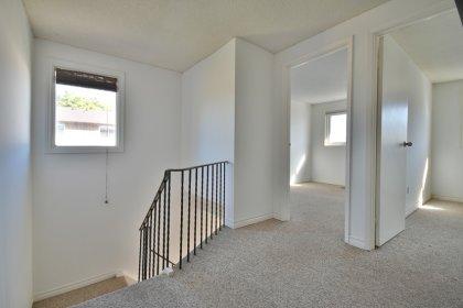 Upper Floor Landing Area With A Large Window.