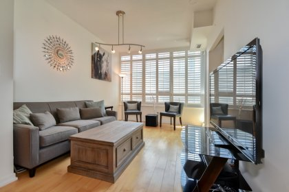 Open Concept Living & Dining Areas With Hardwood Flooring & California Shutters Throughout.