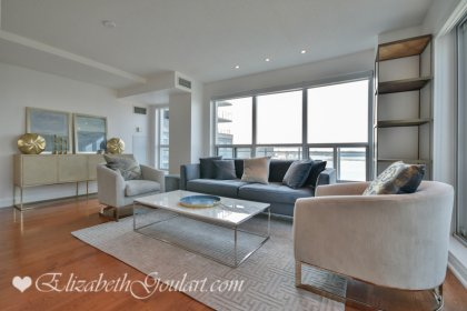 Living And Dining Areas With Bright Floor-To-Ceiling Windows, Pot Lighting & Gleaming Hardwood Flooring Throughout.