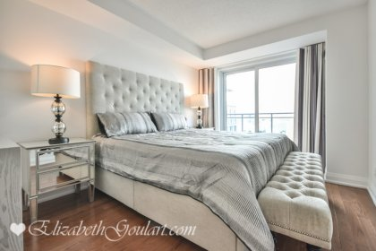 A Spacious Sized Master Bedroom With A 4-Piece Ensuite, Gleaming Hardwood Flooring, A Walk-In Closet & A Walk-Out To The Terrace.