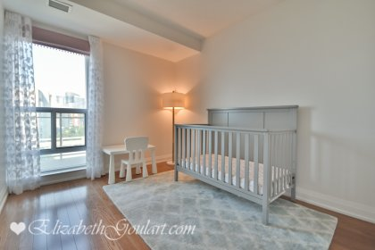 3rd Bedroom With A Large Closet, Gleaming Hardwood Flooring & A Large Window.