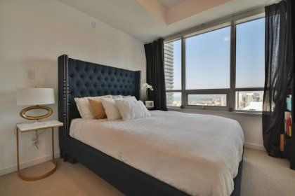 A Spacious Sized Master Bedroom With A 4-Piece Ensuite & Mirrored Closet Facing C.N. Tower Views.