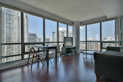Bright Floor-To Ceiling Wrap Around Windows With Laminate Flooring Throughout Facing Stunning Unobstructed C.N. Tower & Lake Views.