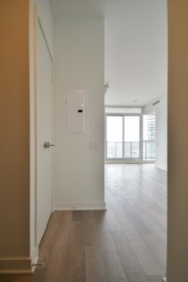 Foyer With Laminate Flooring Throughout.