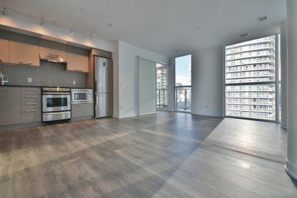Bright 9' Floor-To-Ceiling Wrap Around Windows With Hardwood Flooring Throughout & A Walk-Out Balcony.