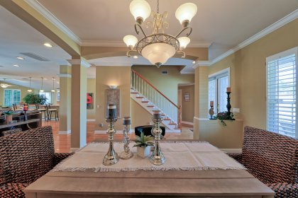 Dining area is open to the entry and family room and is convenient to the kitchen.