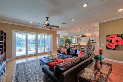 High ceilings in the main living area enhance the open floor plan and display beautiful artwork with custom lighting.