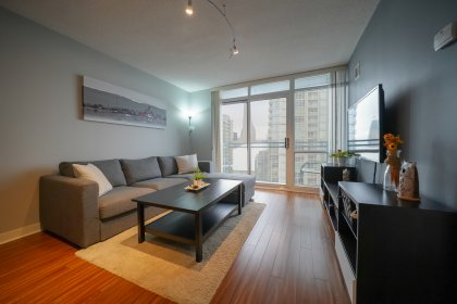 Bright Floor-To-Ceiling Windows With Laminate Flooring Throughout, A Dimmer Lighting Switch And Balcony Facing C.N. Tower & Lake Views.