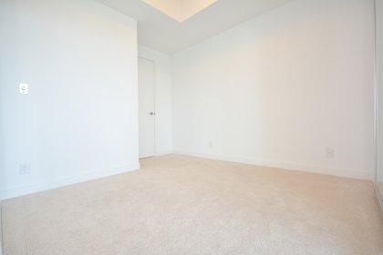 Master Bedroom With Glass Sliding Doors & Walk-In Closet.
