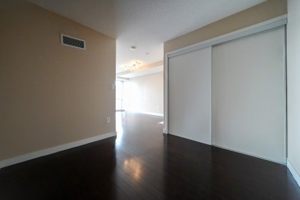 Master Bedroom With Laminate Flooring & A Large Closet.