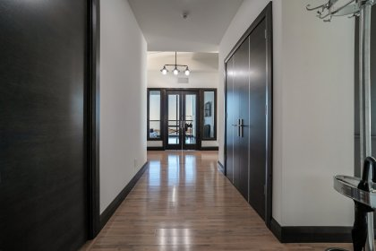 Suite Foyer With Customized Mahogany Doors and Millwork Wood Framing Throughout.