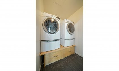 Laundry Room With Ample Storage.