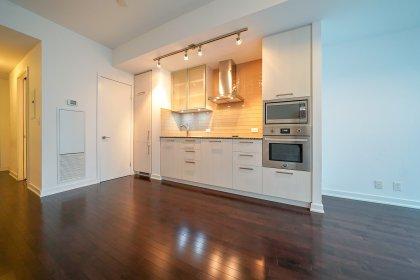 Designer Kitchen Cabinetry With Stainless Steel Appliances, Granite Counter Tops, Undermount Lighting & An Undermount Sink.