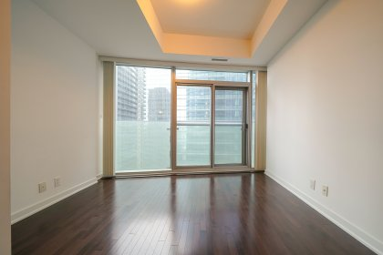 Bright Open Concept Living & Dining Area With 9Ft. Floor-To-Ceiling Windows & Hardwood Flooring Throughout Facing Juliette Balcony CN Tower Views.