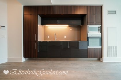 Designer Kitchen Cabinetry With Stainless Steel Appliances, Stone Counter Tops & An Undermount Sink.