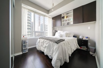A Spacious Sized Master Bedroom With A 4-Piece Ensuite, Mirrored Closet, Laminate Flooring & A Large Window.