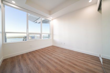 A Spacious Sized 2nd Bedroom Facing Stunning Lake Views With Customized Black-Out Roller Shades & A Mirrored Closet.