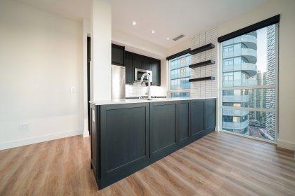 Custom Designer Kitchen Cabinetry With Stainless Steel Appliances, Tile Backsplash, Stone Counter Tops, An Undermount Sink & Pot Lighting.