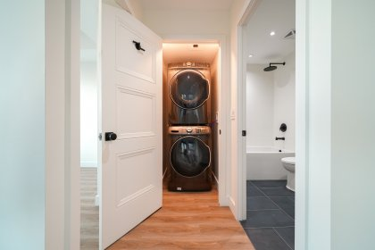 Full Sized Stacked Washer and Dryer.