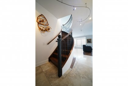 Gorgeous Wood Staircase Leading To The 2nd Floor Area.