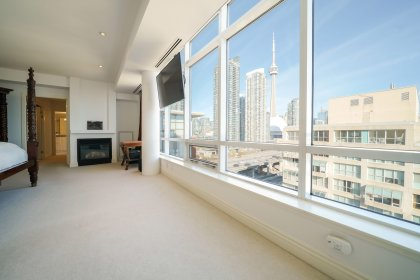 A Massive Master Bedroom With Double Entry Doors, Gas Fireplace, Automated Shades, 2-Walk-In Closets Onlooking Spectacular CN Tower & Lake Views.