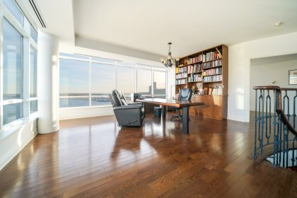 Home Office With Built-In Shelving, Gleaming Hardwood Flooring, Wrap Around Windows With Automated Shades Onlooking Spectacular CN Tower & Lake Views.