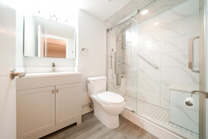 Gorgeous Bathroom With A Glass Framed Multi Jet Spa Shower.