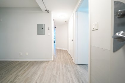 Suite Foyer With Vinyl Flooring Throughout.