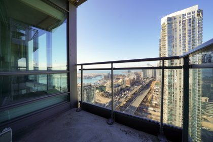 Private Balcony Facing Stunning West Island Airport & Lake Views.