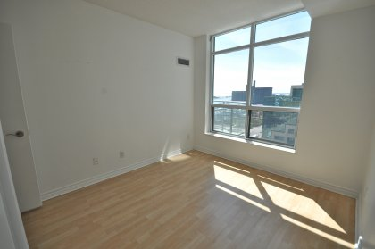 Spacious Sized Bedroom With Laminate Flooring Through-Out Facing The Lake & The Music Garden Park.
