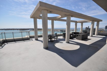 The Exclusive Outdoor Wrap-A-Round Roof Top Terrace Faces Spectacular & Stunning Panoramic CN Tower, Lake, Island Airport & City Views Of Toronto. The