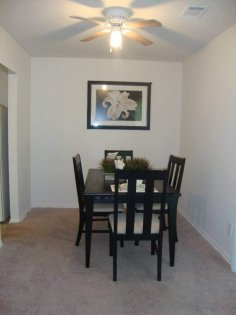 Serene dining room with overhead fan to help cool things down and lower your energy usage