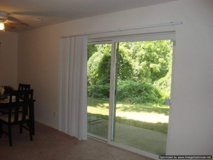 Patio door that slides to the side (with your help of course :) to let in fresh air. Did you notice the vertical blinds too?