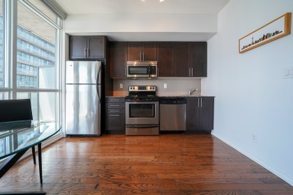 Designer Kitchen Cabinetry With Stainless Steel Appliances & Granite Counter Tops.