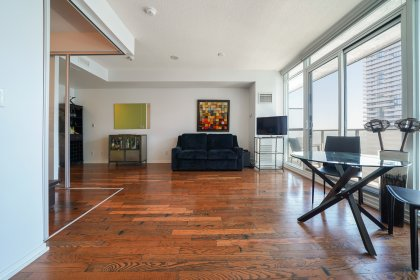 Bright 9' Floor To Ceiling Windows With Custom Roller Shades & Hardwood Flooring Throughout Facing South Lake Views.