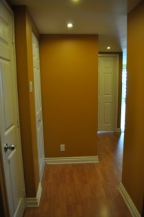 9Ft. Ceiling With Designer Paint, Lined Pot Lighting & Gleaming Hardwood Flooring.