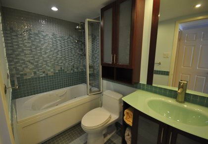 The Showpiece Master En Suite Features Meticulous Italian Tile Work With A MAAX Jacuzzi & Over Sized Rain Shower Head.