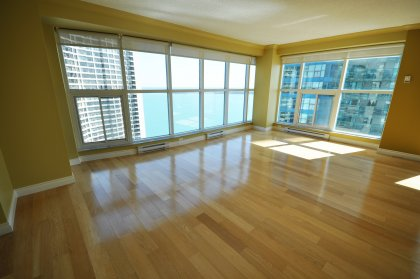 The Bright & Spacious Open Concept Living & Dining Areas Have Wrap-A-Round 9Ft. Floor-To-Ceiling Windows Overlooking Picturesque Lake Views.