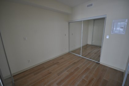 Real Oak Plank Hardwood Flooring Through-Out On A State-Of-The-Art Sound Attenuation System With A Large Mirrored Closet.