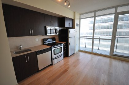 Upgraded Stainless Steel Appliances With Custom Stone Counter Tops & Real Oak Plank Hardwood Flooring Through-Out On A State-Of-The-Art Sound System.