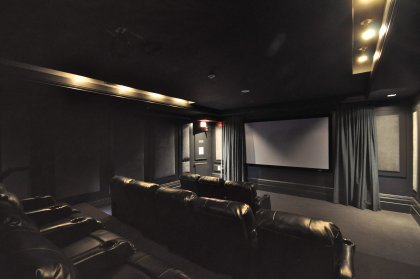 State-Of-The-Art Private Theatre Room With Real Theatre Experience Recliner Seating, Sound System & Projection Screening.