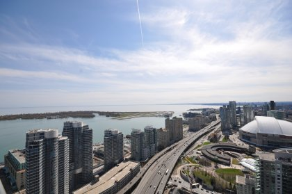 Absolutely Spectacular & Unobstucted Panoramic Views Of Toronto's Harbourfront, Lake Ontario, The City Island Airport, CN Tower & Rogers Centre.
