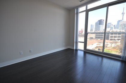 Spacious Sized Master Bedroom With Juliette Balcony, Custom Closet Organizers, Floor-To-Ceiling Windows, Laminate Flooring Through-Out With CN Tower &