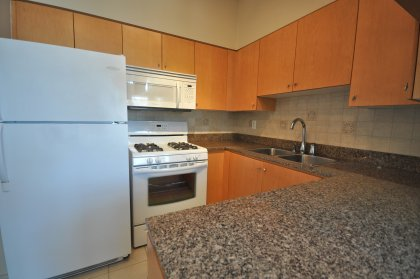 Designer Kitchen Cabinetry With Gas Stove & Granite Counter Tops.
