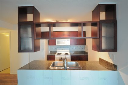 Designer Kitchen Cabinetry With Granite Counter Tops & Ceramic Backsplash.