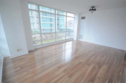 Floor-To-Ceiling Windows With New Laminate Flooring Onlooking The Rooftop Garden, Tanning Deck & BBQ's.