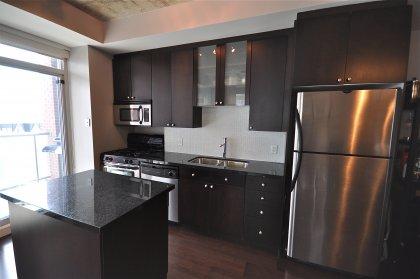 Designer Kitchen Cabinetry, Granite Counter Tops, Mobile Island, Stainless Steel Appliances with Gas Stove.