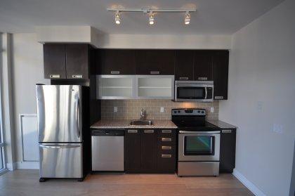 With Stainless Steel Appliances, Granite Counter Tops, Ceramic Backsplash & Hardwood Flooring.
