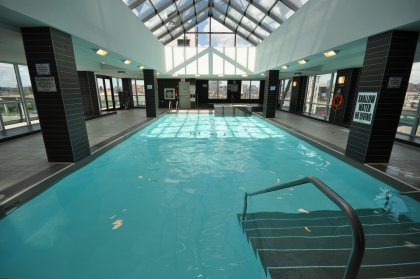 Indoor Heated Pool & Jacuzzi With Outdoor Tanning Deck Area.
